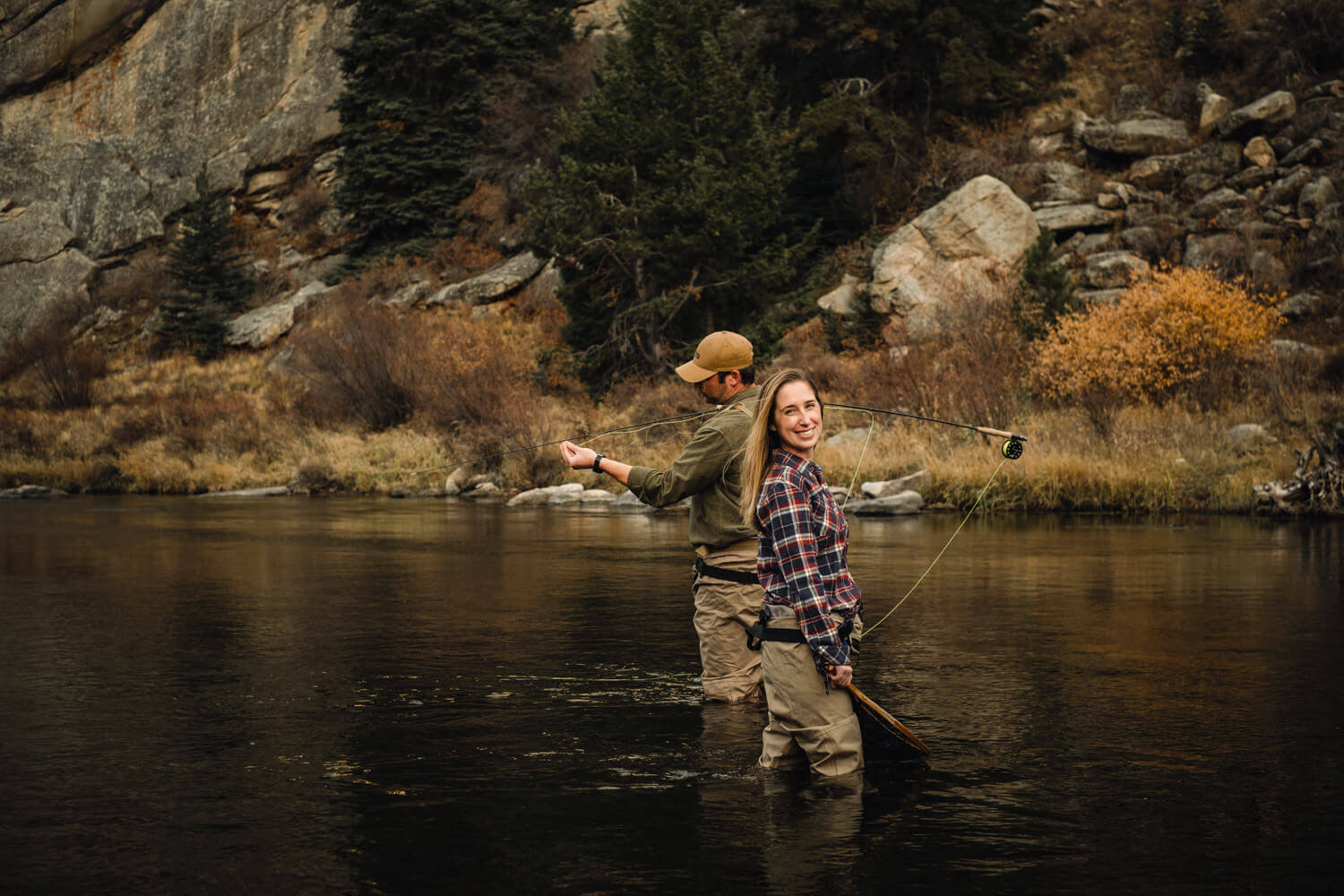 Man and woman anglers in Eleven Mile Canyon River.