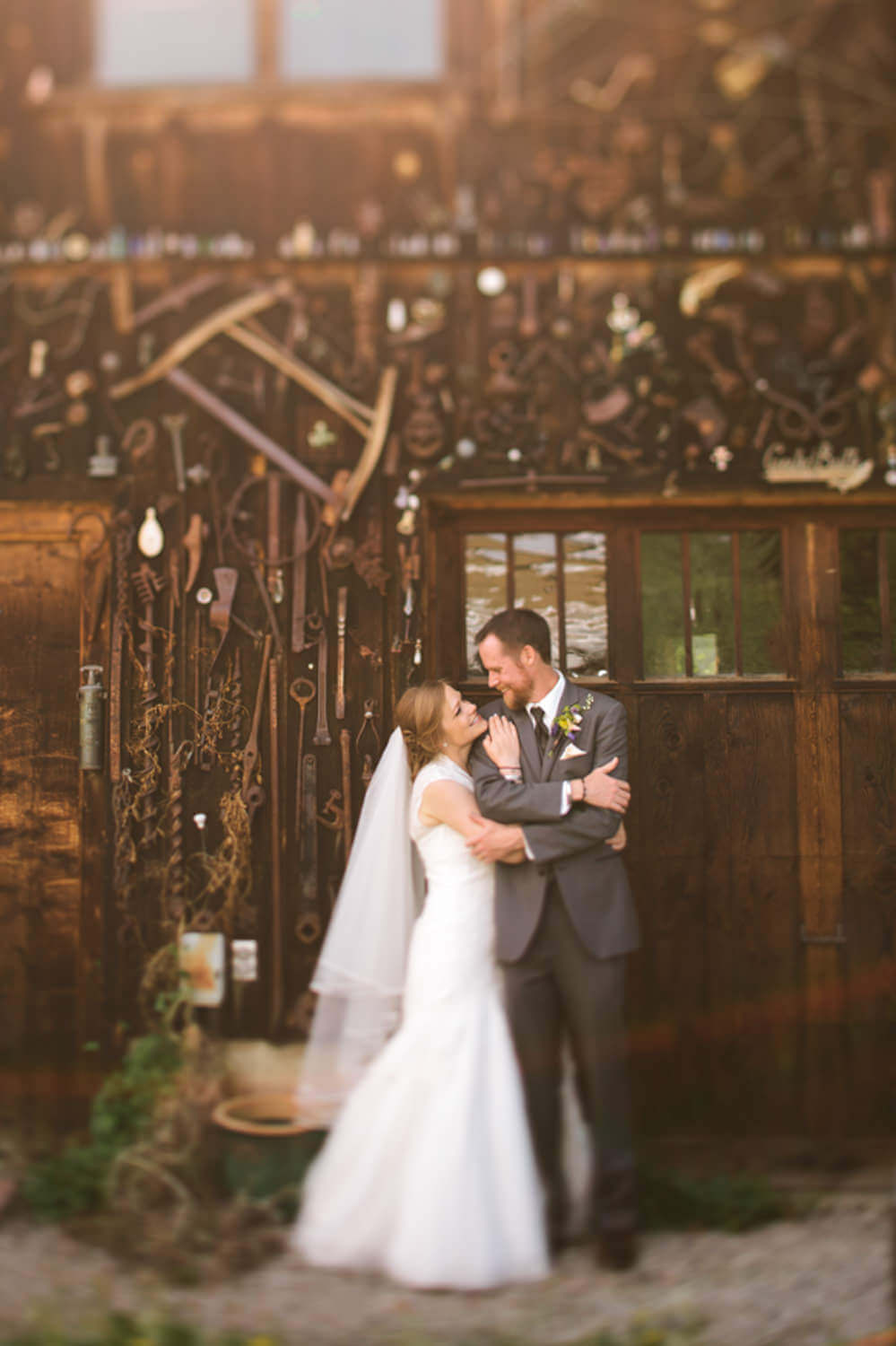 Couple embraces in front of rustic building in Crested Butte, Colorado.