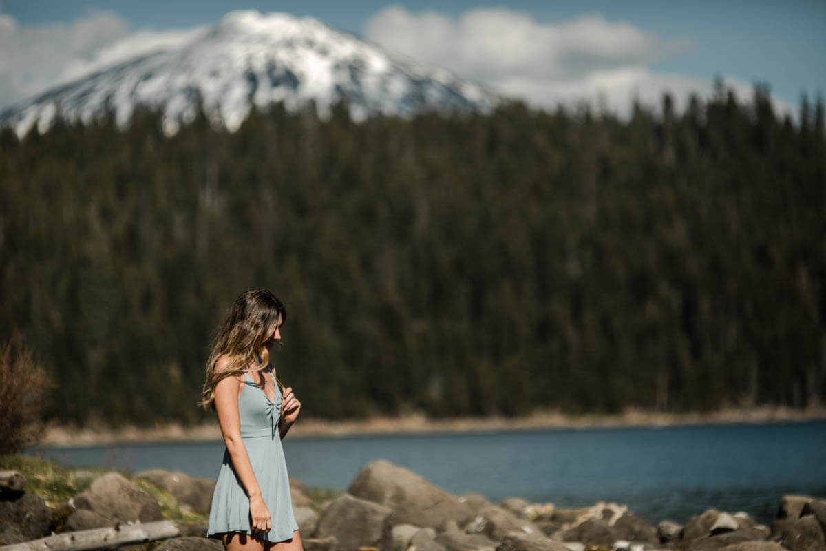 girl in short blue dress, mount bachelor in the distance