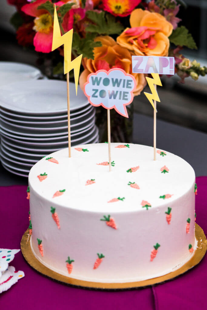 Playful signs and bright carrot cake.