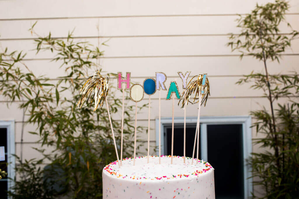 bright cake with hooray decor.