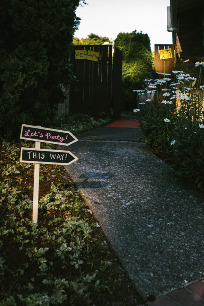 Let's party sign points to backyard.