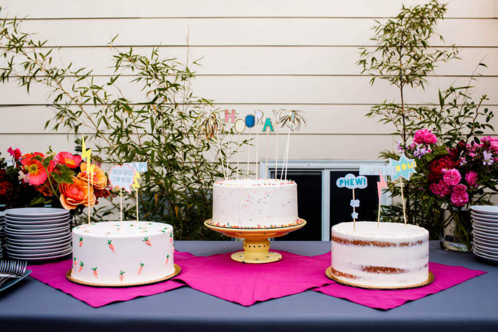Dream Cakes of Portland; table of bright and cheerful cakes.