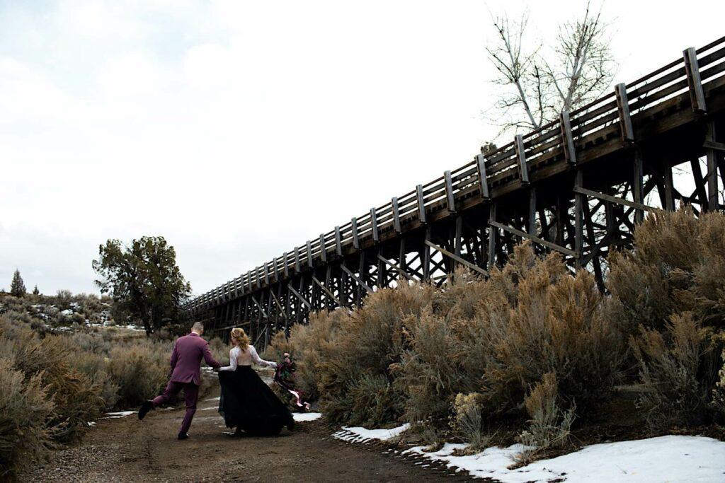Frolicking newly weds near iconic bridge at Brasada.