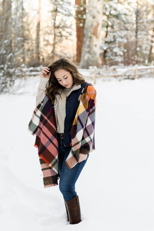 Candid senior photo in winter scene.