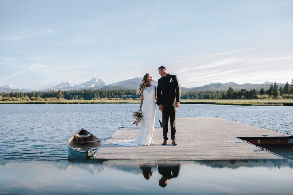 Couple standing on dock at Black Butte Ranch.