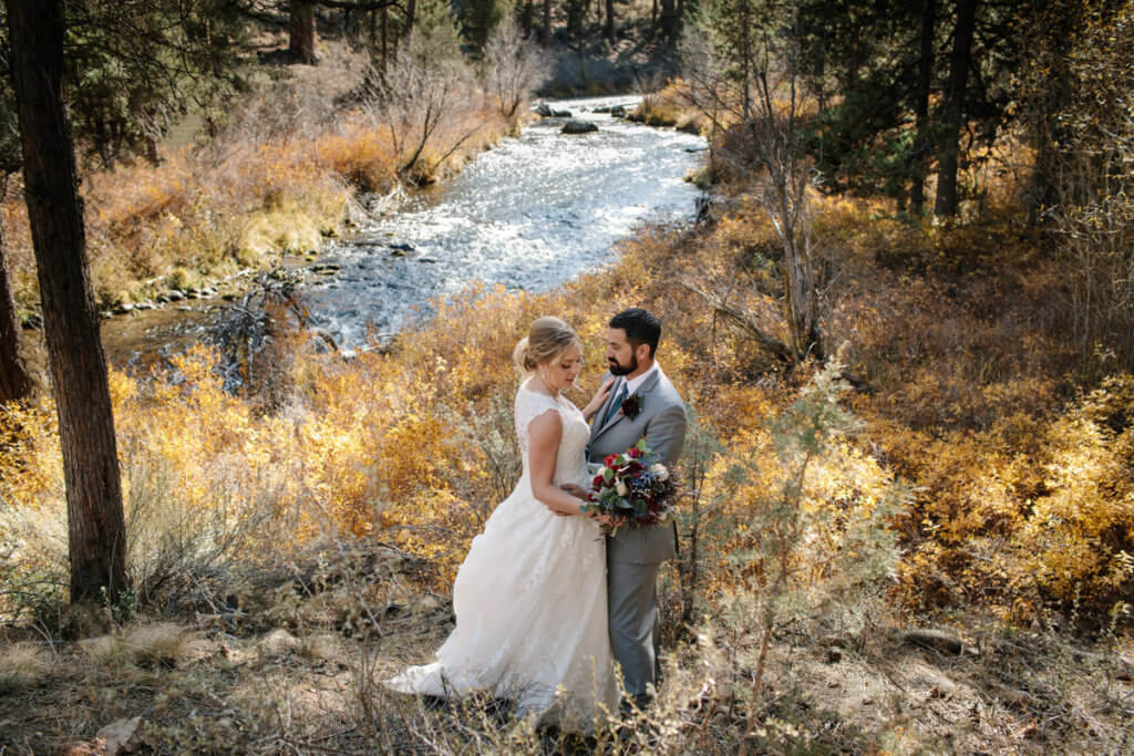 Couple near creek at Aspen Hall, Bend.