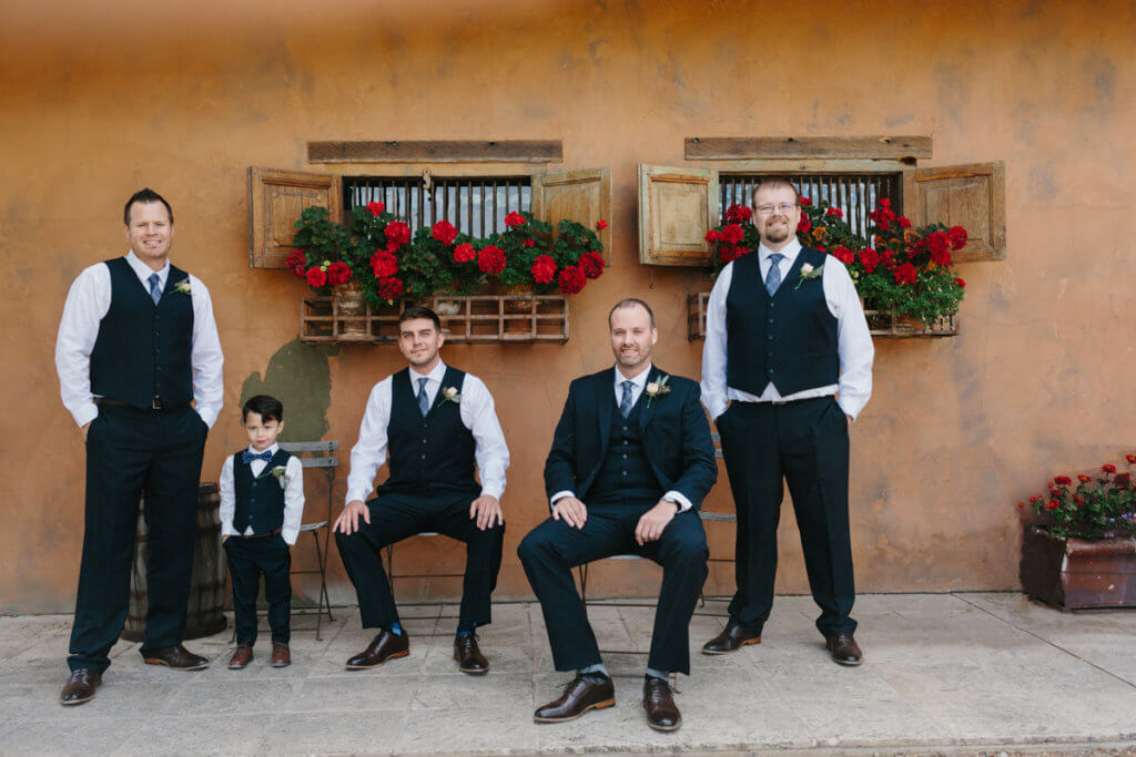 Groom and his guys outside the tuscan inspire Ranch at the Canyons.