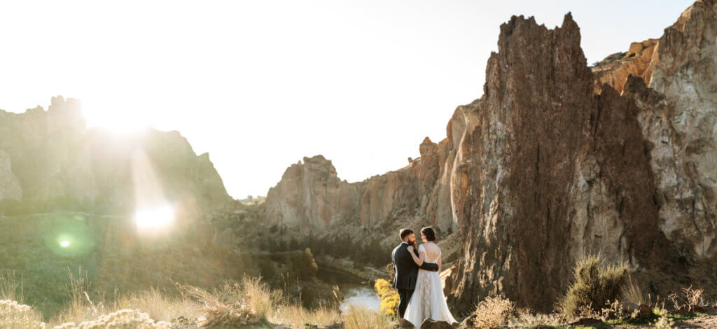 Panoramic photo of Smith Rock with newlyweds.